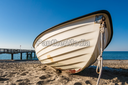 a fishing boat on the beach