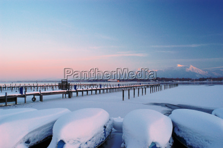 snow covered rowing boats on the