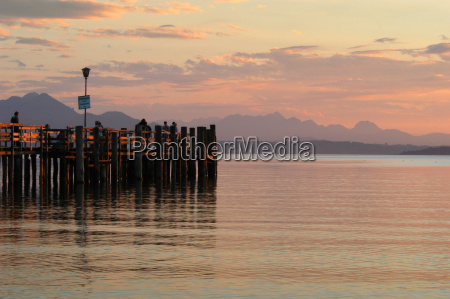 jetty on chiemsee after sunset bavaria