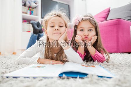 happy little girls read book