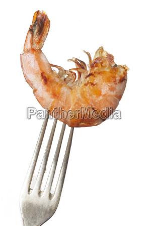 grilled shrimp on a fork on