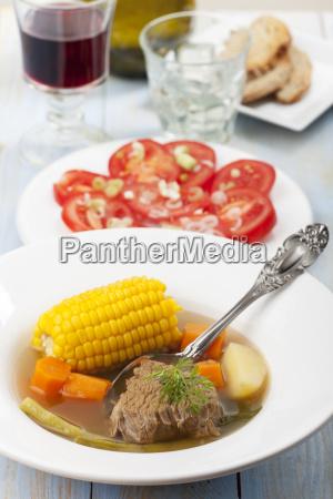 chilean cazuela with tomato salad