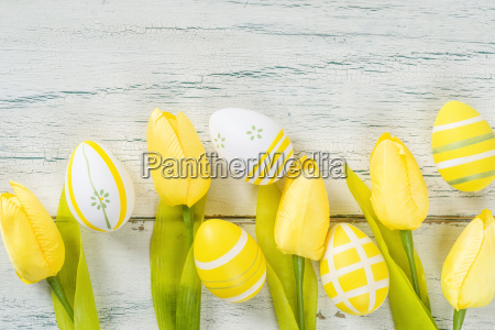 easter eggs and tulips with copy