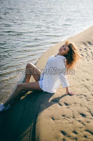 lovely young woman with curly hair