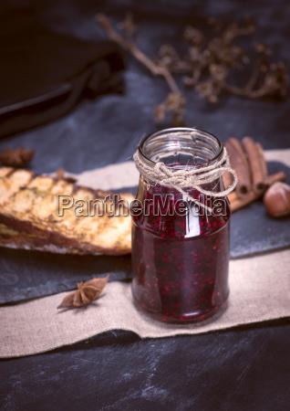 glass jar with raspberry jam