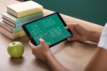 human hand solving math problems on