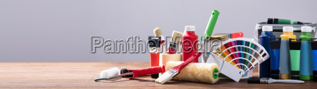 painting equipments on the wooden table