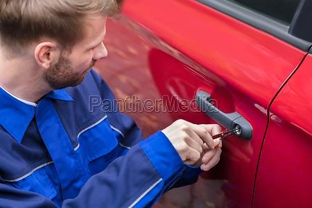 human hand opening cars door with