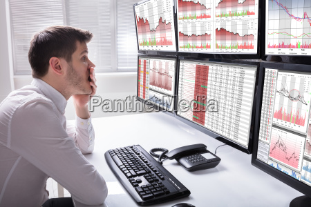 sad male operator looking at graphs