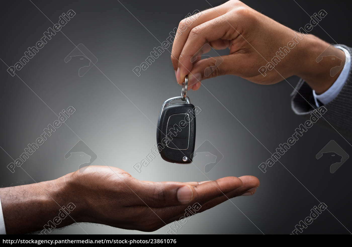 hand, passing, car's, key, to, new - 23861076