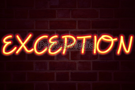 exception neon sign on brick wall