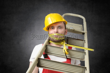 clumsy worker with measure tape