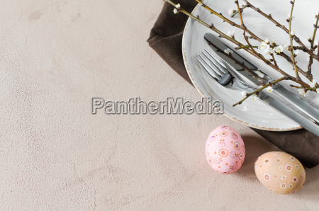 easter table setting with spring branches