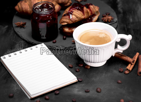 cup with black coffee and an