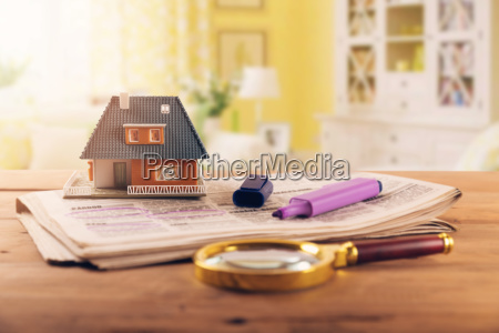 searching new house in newspaper real