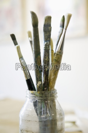 paintbrushes in glass jar