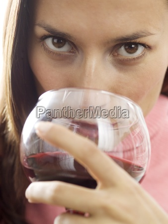 a woman sipping red wine
