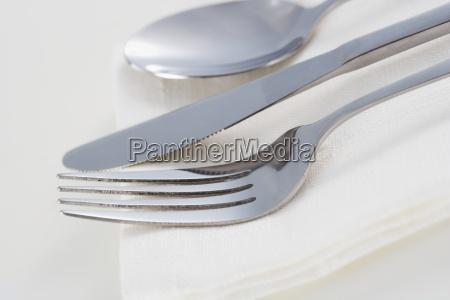still life of silverware and napkin