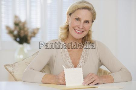 senior woman writing card