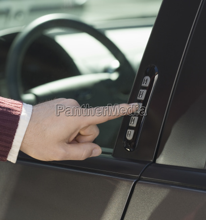 man unlocking car door with keypad