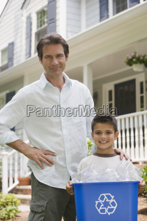 father and son with recycling bin