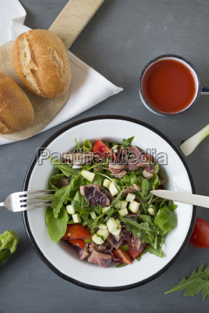 seafood salad in bowl and cherry