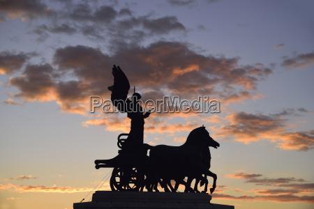 silhouette of goddess victoria on altare