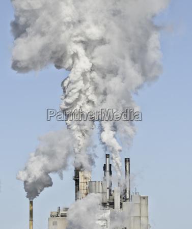 smoke stacks emitting smoke