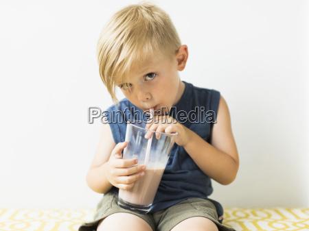 young boy 2 3 drinking milkshake