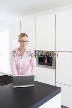 woman using on laptop at home