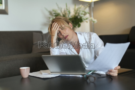 portrait of overworked woman using computer