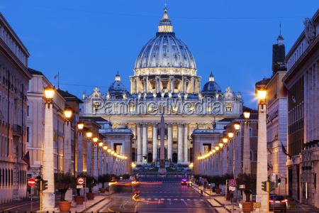 illuminated st peters basilica with asphalt