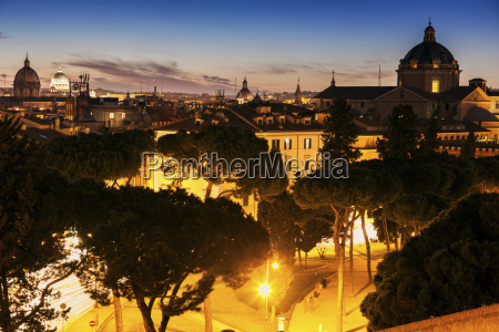 illuminated townscape with domes at sunset