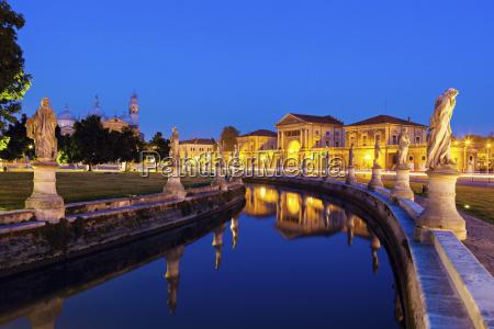 illuminated prato della valle with statues