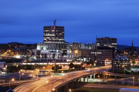 illuminated overcrossing in city at dusk