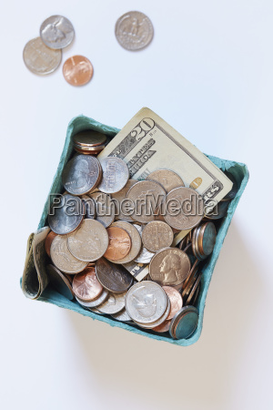 coins and banknotes in carton box