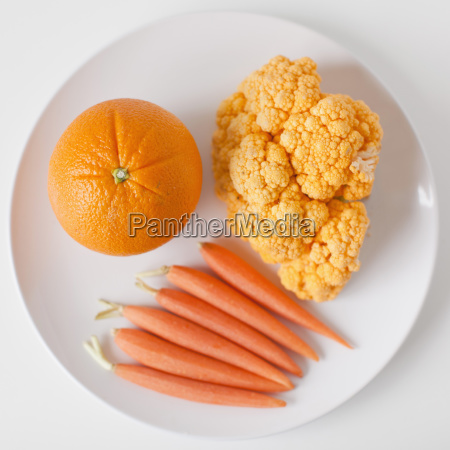 orange fruits and vegetables on plate
