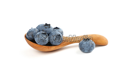 fresh blueberry in wooden spoon isolated