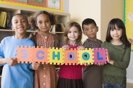 portrait of schoolchildren 6 7 holding