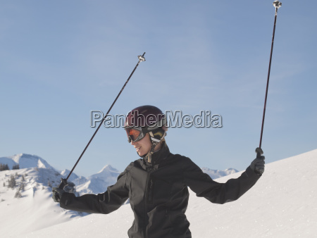young woman in ski gear at