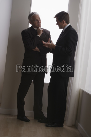 two business men discussing in office