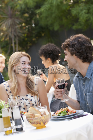 couple dining in outdoor restaurant