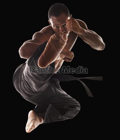 studio shot of martial arts practitioner