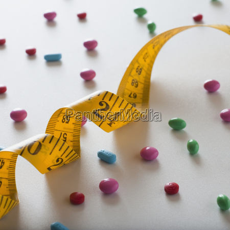 measuring tape and diet pills
