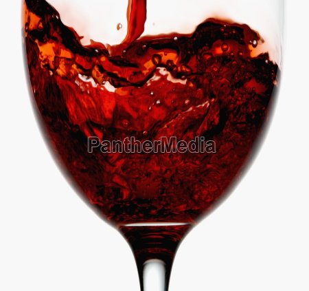 red wine being poured into wineglass