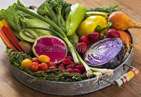 fruit vegetables and herbs on tray
