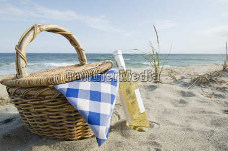 picnic basket and white wine on