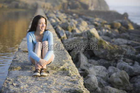 a woman sitting on a stone