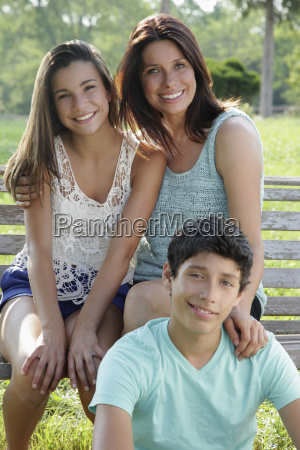 outdoor portrait of smiling mother with