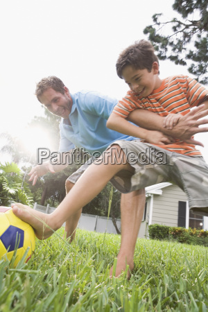 father, and, son, playing, soccer, in - 23973820